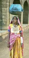 Woman with a heavy silver necklace which she wanted to sell, Bijapur, India